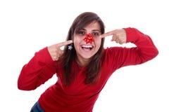 滑稽她的鼻子丝带圣诞老人妇女年轻人 免版税库存图片