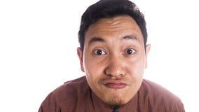 滑稽的亚洲人关闭微笑的鸭子面孔 库存图片
