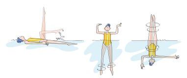 滑稽的同步的女孩实践的游泳 库存图片