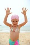 滑稽的女孩一点泳装佩带 免版税图库摄影