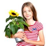 滑稽的女孩向日葵 库存图片