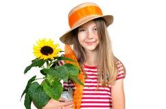 滑稽的女孩帽子向日葵 图库摄影