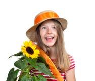 滑稽的女孩帽子向日葵 库存照片