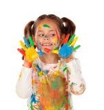 滑稽的女孩用充分手和面孔的油漆 库存照片