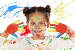 滑稽的女孩用充分手和面孔的油漆 免版税库存图片
