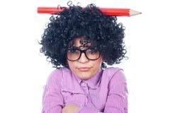 滑稽的女小学生 免版税库存照片