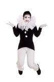 滑稽的女性小丑跳 免版税库存照片