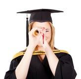 滑稽的女性毕业生 库存照片