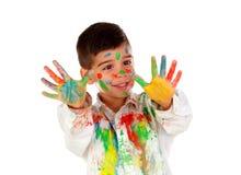 滑稽的男孩用充分手和面孔的油漆 免版税图库摄影