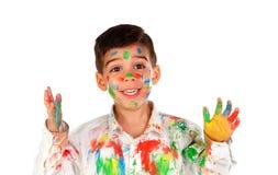 滑稽的男孩用充分手和面孔的油漆 免版税库存照片