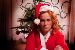 滑稽的看起来的坏圣诞老人女孩 库存图片
