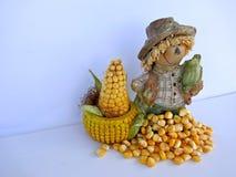 滑稽的装饰的图用玉米,被隔绝在白色背景 免版税库存照片