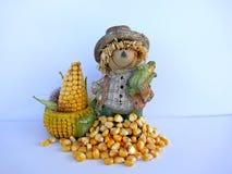 滑稽的装饰的图用玉米,被隔绝在白色背景 库存照片