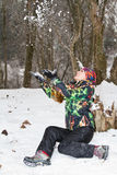 滑雪雪诉讼投掷的妇女 库存图片
