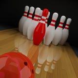 滚保龄球的红色九柱游戏用的小柱 图库摄影