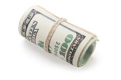 滚的货币美元 库存图片