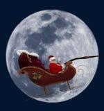 满月圣诞老人 免版税库存图片