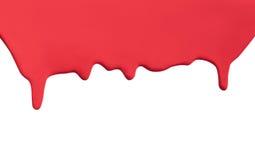 滴水流的油漆红色 免版税库存照片
