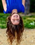 漂亮的孩子垂悬的上部和笑 库存照片