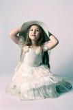 漂亮的孩子礼服典雅的女孩帽子 图库摄影