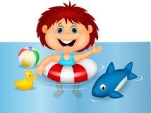 漂浮与可膨胀的圆环的女孩动画片 免版税库存照片