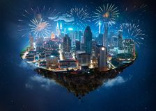 漂浮在与现代城市的天空中的幻想海岛 库存照片
