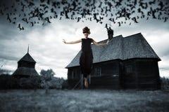 漂浮在天空中的巫婆 免版税库存照片