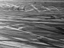 漂移的柏油碎石地面 免版税库存照片
