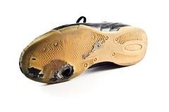 漏洞穿上鞋子被佩带的体育运动 图库摄影
