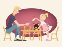 演奏与她的父亲的小孩女孩茶会 库存图片