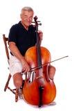 演奏前辈的大提琴 免版税库存照片