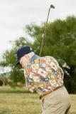 演奏前辈的高尔夫球人 库存图片