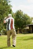 演奏前辈的高尔夫球人 图库摄影