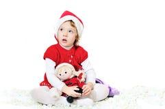 演奏圣诞老人的女孩 免版税库存图片