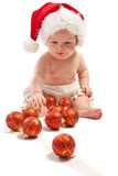 演奏圣诞老人的婴孩帽子 免版税库存照片