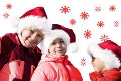演奏圣诞老人的3个克劳斯孩子 免版税库存图片