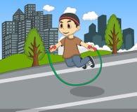 演奏在街道动画片的小孩跳绳 库存图片