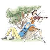 演奏夫妇的小提琴 免版税库存照片