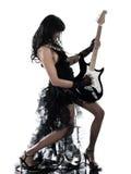 演奏妇女的电吉他球员 免版税库存照片