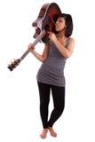 演奏妇女年轻人的黑色吉他 图库摄影