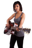 演奏妇女年轻人的黑色吉他 库存照片