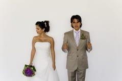演奏婚礼的cuple拘留 免版税库存图片