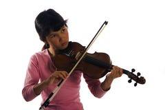 演奏小提琴年轻人的女孩 库存照片