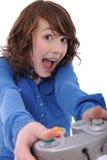 演奏少年计算机游戏的女孩 免版税库存图片