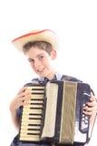 演奏年轻人的手风琴男孩 免版税库存图片