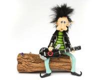 演奏摇摆物的矮小的吉他 免版税库存照片