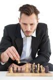 演奏棋独奏的被聚焦的商人 库存照片