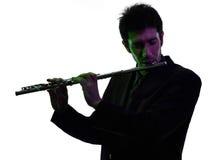 演奏横长笛演员剪影的人 免版税库存照片