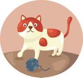 演奏毛线的逗人喜爱的猫 免版税库存照片