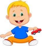 演奏汽车玩具的婴孩动画片 图库摄影
